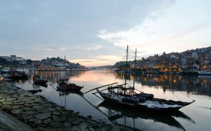 Port wine boats on the Douro River at sunset, Porto, Portugal | Picture: © Renato Granieri / Alamy